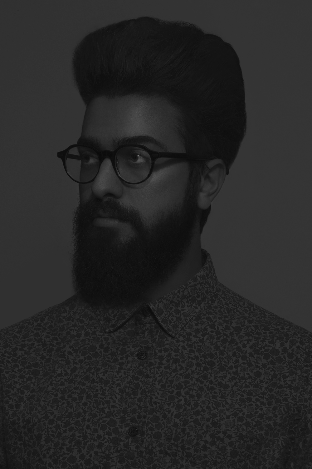 Black and white photo of a man's portrait with beard