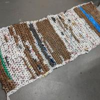 Floor mat made of single use plastic bags