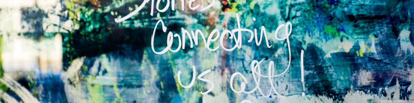 "Painting with ""Stories Connecting Us All"" in words"