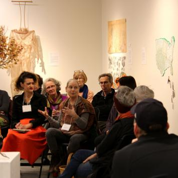 Migration - Photo by Li Peng, of artists Nayda Cuevas and Louise Berliner, work by Jodi Colella, Nancy Crasco and Tica deMoor