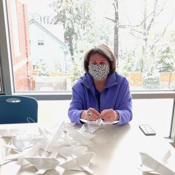 Volunteer Making Artfest Dedication Doves by Ellen McHale