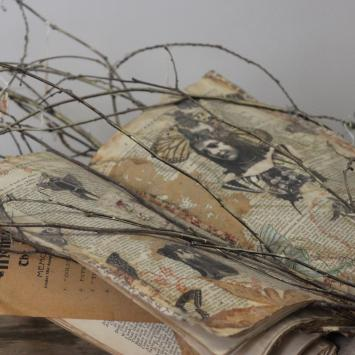 Max Payne book sculpture with branches