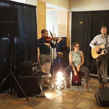Cory Allen Staats performs at the reception before the Merchant Show (Photo by Stewart Ikeda)
