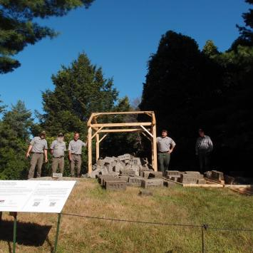 Rangers from the National Park Service help install Witness at Minute Man National Park