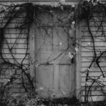 "Nancy Roberts, ""Farmhouse Door,"" framed black and white silver gelatin print (4.5"" X 6"")"