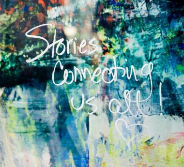 """Painting with """"Stories Connecting Us All"""" in words"""