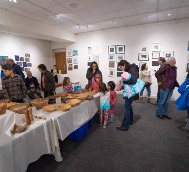 Vendors selling work in the gallery space